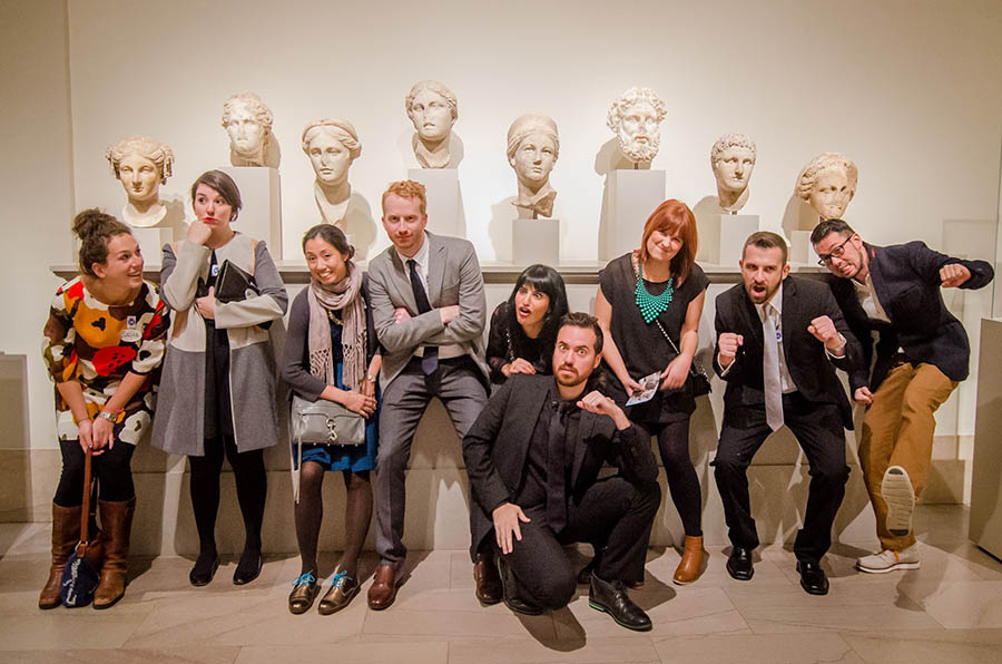 A VIP group poses with the art.